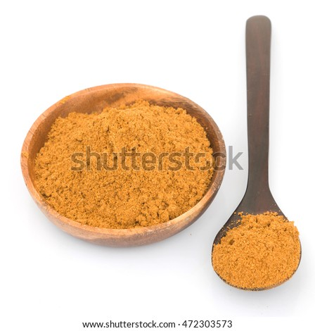 Garam masala or mix spices blend in wooden bowl and spoon over white background