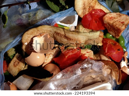 Garbage and food remains in trash bag - stock photo