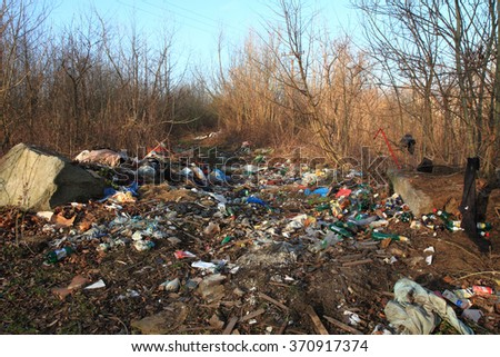 garbage and nature is a big actual problem - stock photo