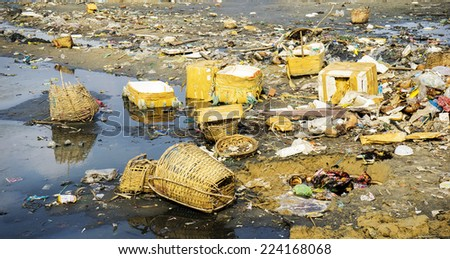 garbage and wastes on the beach. Vietnam has a lot of beach litter. - stock photo