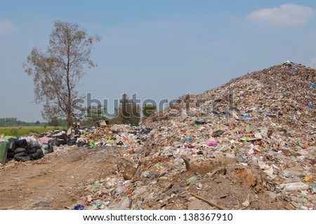 Garbage at a rubbish dump in a landfill site, pollution, Global warming - stock photo
