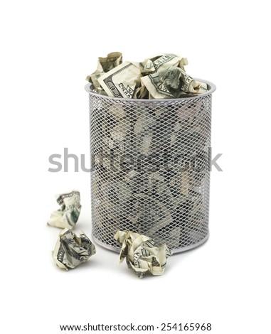 Garbage bin full of cash - stock photo