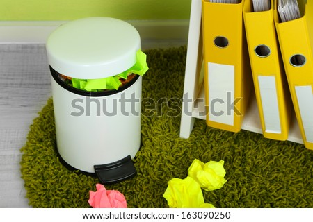 Garbage bin, on office background - stock photo