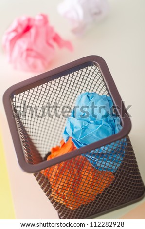 Garbage bin with paper waste - stock photo