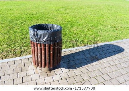 garbage can in a park - stock photo