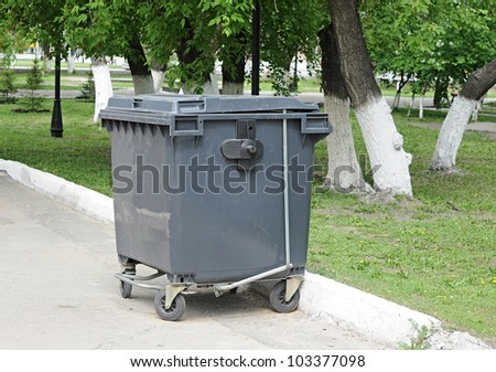 garbage can on the side of the road - stock photo