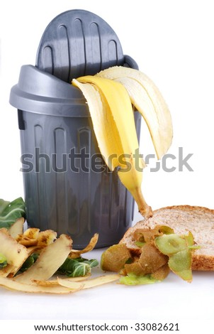 Garbage can with green waste; isolated on a white background.