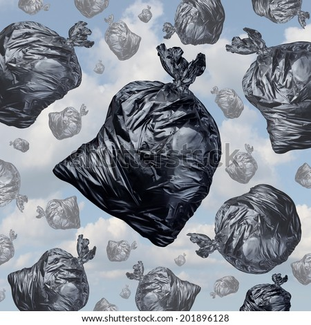Garbage concept as black trash bags with an unpleasant smell falling from the sky as a background of environmental damage issues and waste management problems. - stock photo