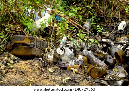 garbage dump on the nature - stock photo