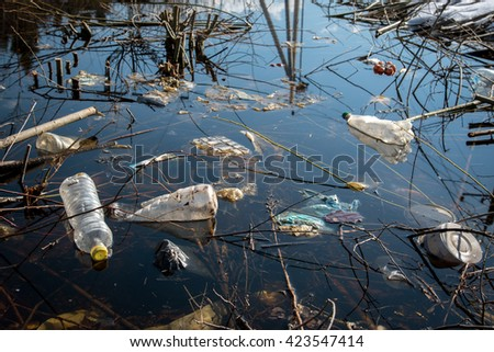 garbage floating in the water - stock photo