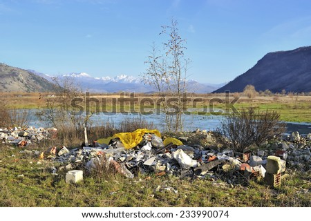Garbage in beautiful natural landscape - stock photo
