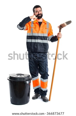 Garbage man making phone gesture
