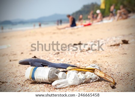 Garbage on a beach left by tourists, environmental pollution concept picture. - stock photo