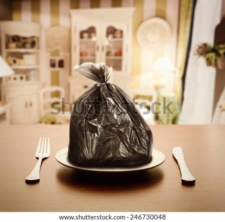Garbage package instead of food - stock photo