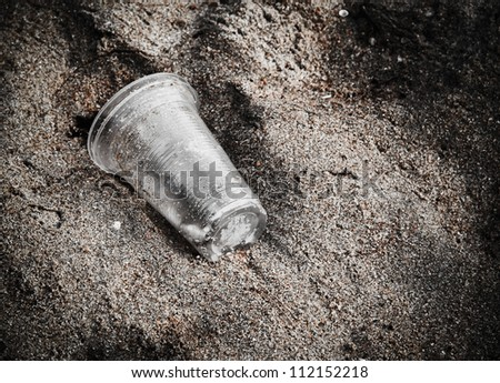 garbage plastic glass on the beach - stock photo