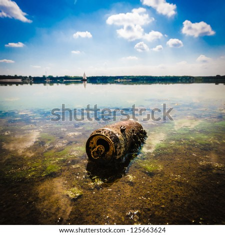garbage polluting the natural environment, pollution, nature series - stock photo
