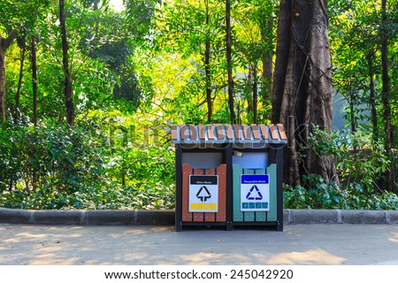Garbage recycle bin on street in park - stock photo