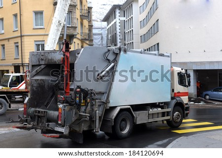 garbage truck in the street cities - stock photo