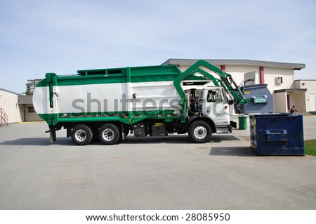 Garbage truck is working - stock photo