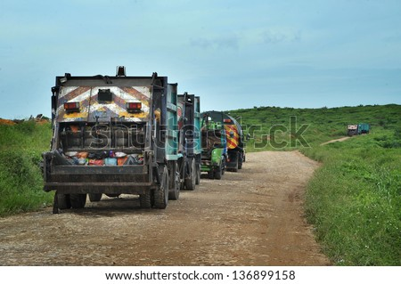 Garbage Trucks on their way to landfill - stock photo