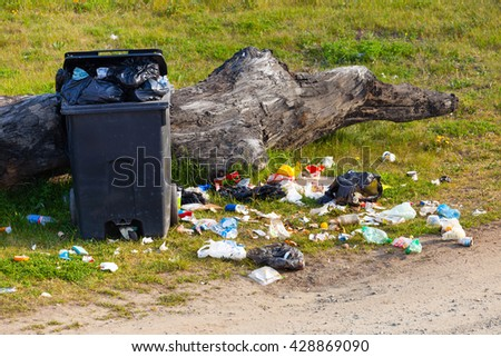 Garbage waste in park full of all sort of trash. - stock photo