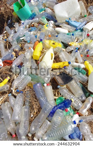 garbages, plastic, and wastes on the beach after winter storms. - stock photo