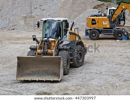 GARCHING, GERMANY - JULY 3, 2016.  Construction site with excavator and bulldozer