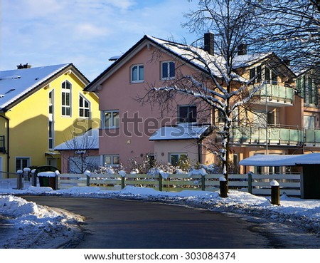 Garching, Germany - modern residences in urban street with snow - stock photo
