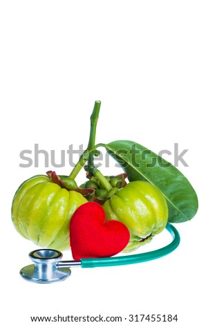 Garcinia atroviridis fresh fruit, red heart-shaped and stethoscope. Isolated on white background. Thai herb and sour flavor lots of vitamin C and good for health. Extract as a weight loss product. - stock photo