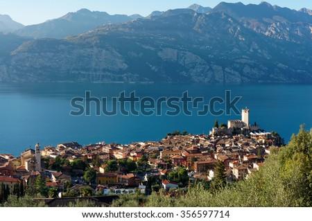Garda lake and Malcesine town in autumn, Italy - stock photo