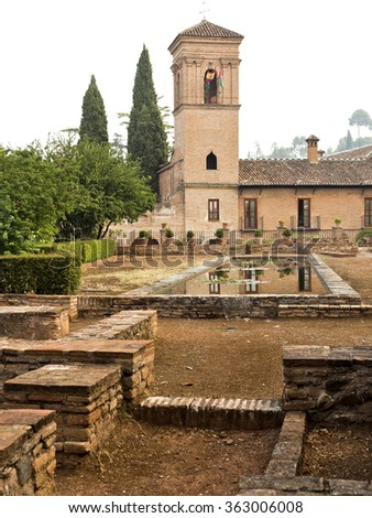 Garden and Bell Tower of the former Franciscan Convent at the Medina in The Alhambra, Granada, Spain - stock photo