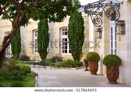Garden and terrace of a luxury French mansion near Bordeaux