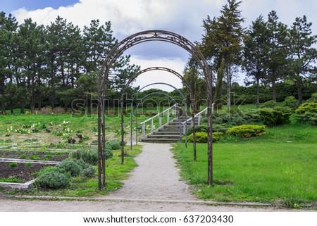 Garden Arches And Pathway In Botanical Garden