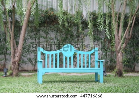 Garden bench and background blur - stock photo
