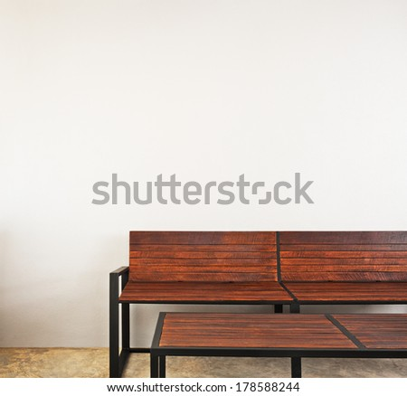 Garden bench as interior furniture brown in color - stock photo