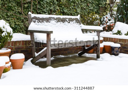 Garden bench in snow