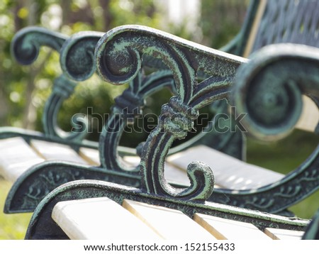 garden bench with ornaments