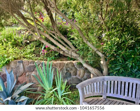 Garden bench with rock wall
