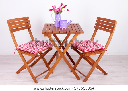 Garden chairs and table on white background - stock photo