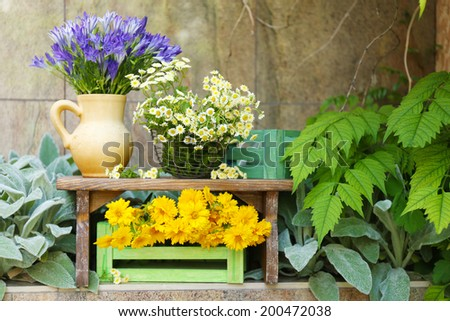 Garden decoration with wildflowers, outdoors - stock photo