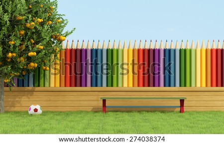 Garden for children with bench on the grass and fence with colorful pencils - 3D Rendering - stock photo