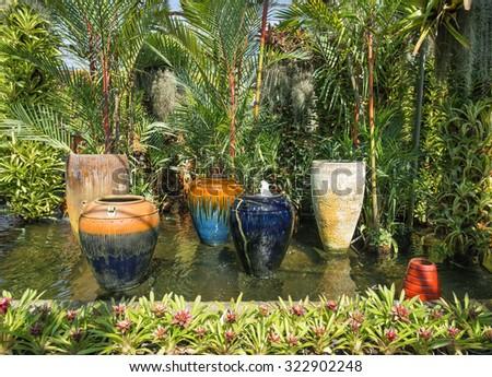 garden fountain and pond - stock photo
