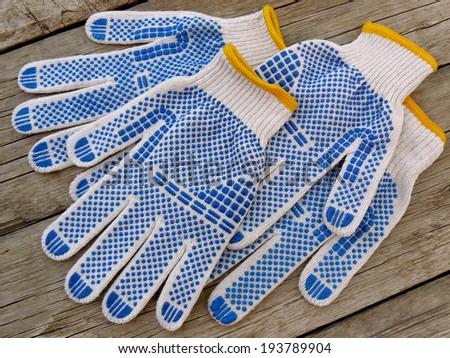 garden gloves on wooden background - stock photo