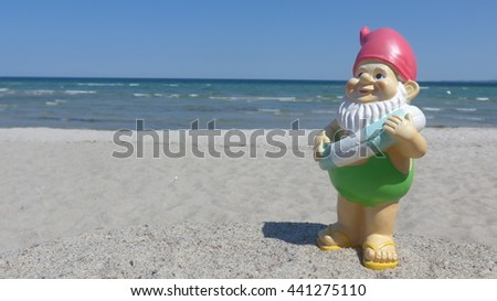Garden gnome on vacation at sea