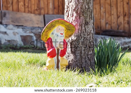 Garden gnomes in an autumn garden in the grass - stock photo