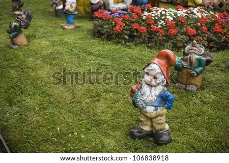Garden gnomes on a lawn. - stock photo