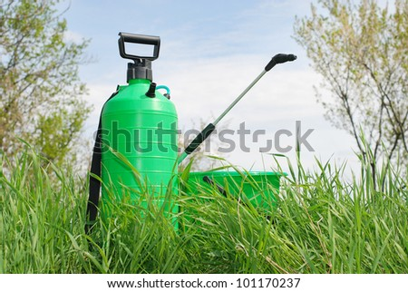 Garden handheld sprinkler in the grass