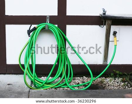 garden hose and drinking fountain - stock photo