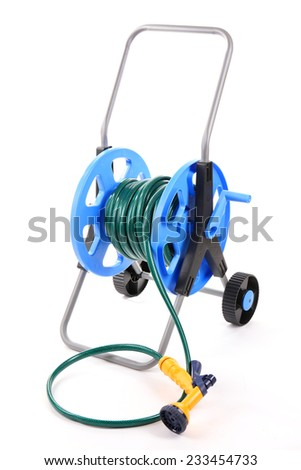 Garden hose on wheels isolated on white