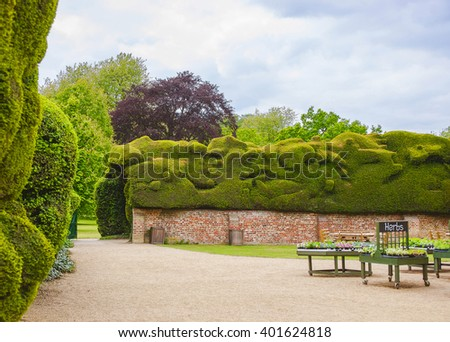 Garden in Backyard of Audley End House in Essex in England. It is a medieval county house. Now it is under protection of the English Heritage. - stock photo